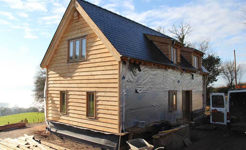 western red cedar oak frame home in the process of being clad