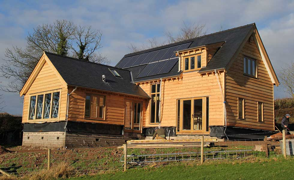 western red cedar timber frame home with weatherboarding