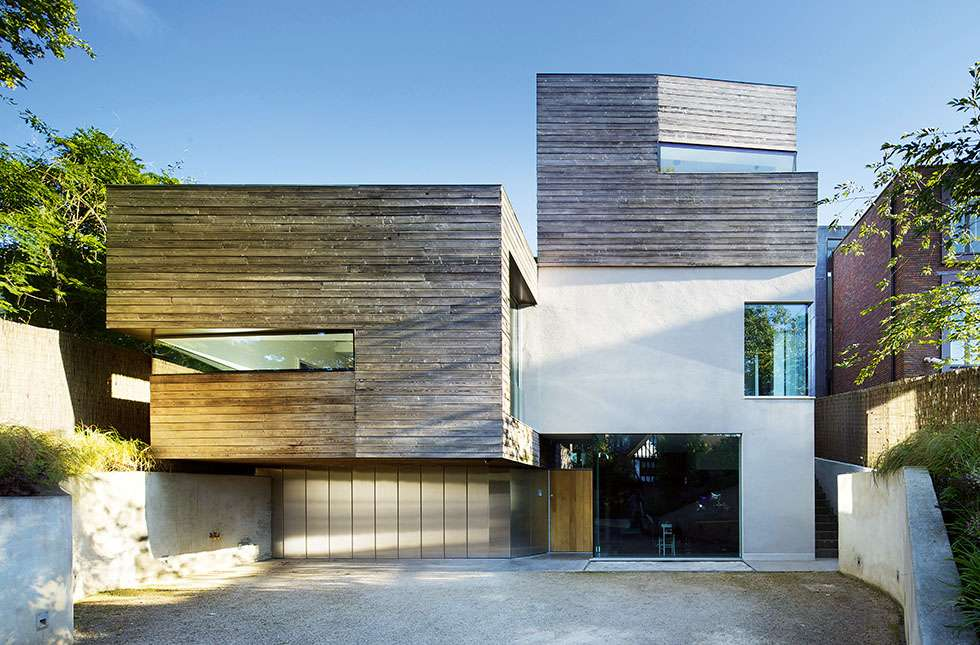 industrial modernist-style home sloping site