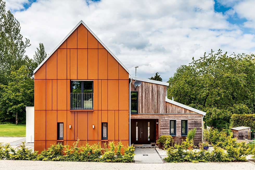 self build house with corten and timber cladding