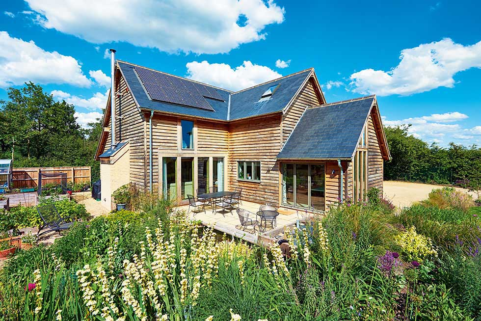 oak frame home with timber cladding and solar panels