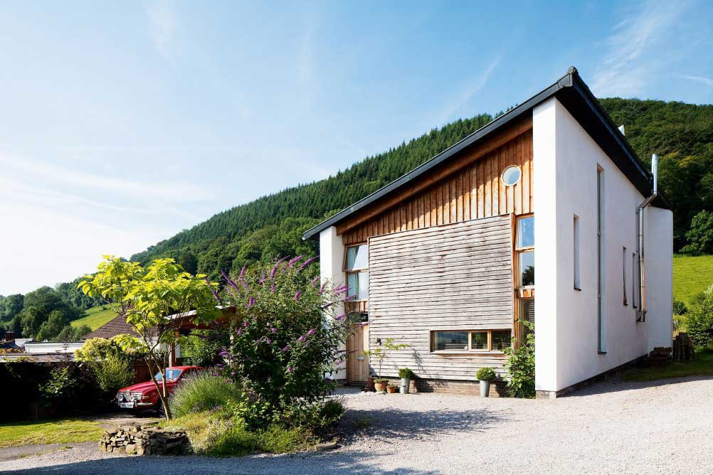 angular self build home with monopitch roof in countryside