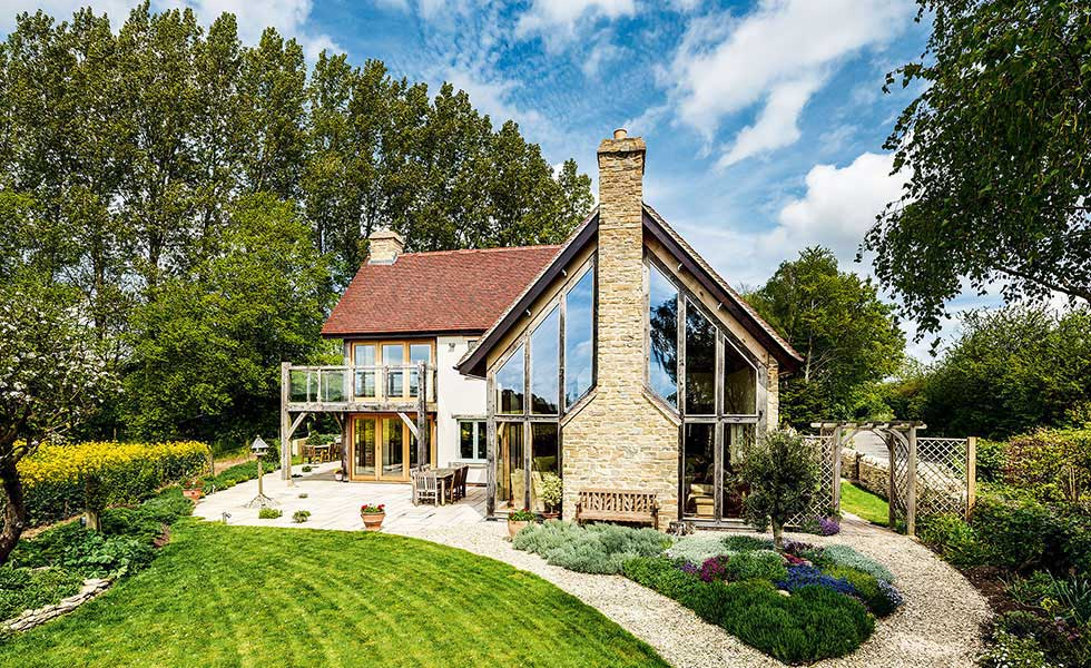 oak frame self build home with fixed glazed elevation