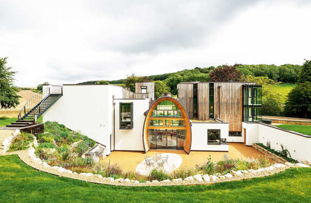 imaginative self build home with large arched entrance