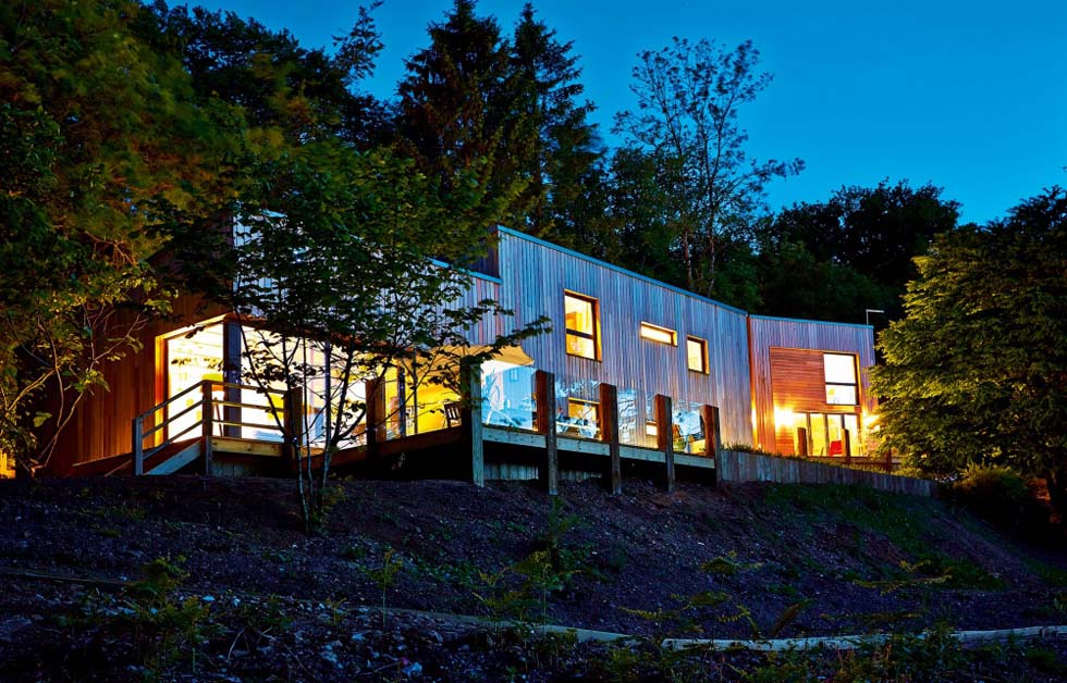 contemporary self build home in woodland with cedar cladding