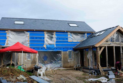 plastic covered oak frame and hempcrete house