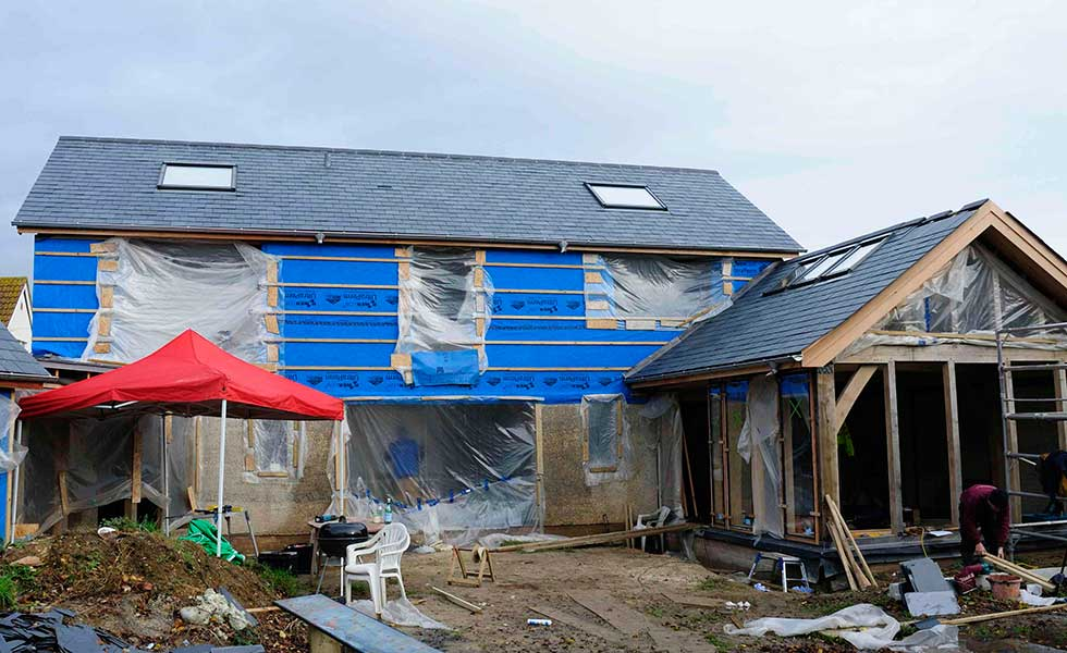 plastic covered oak frame and hempcrete house
