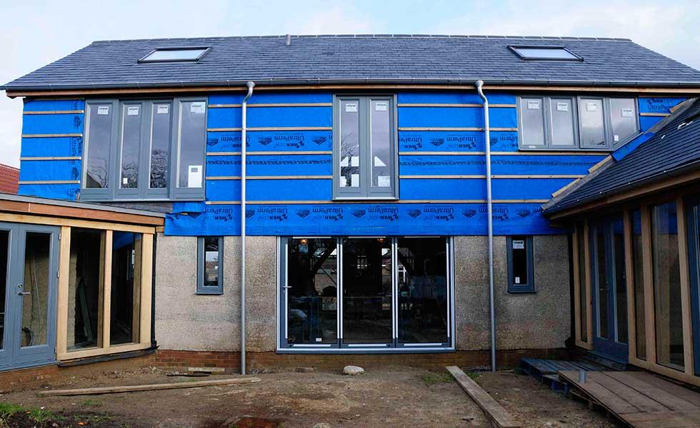 bi-fold doors and a juliet balcony and casement windows on oak frame self build
