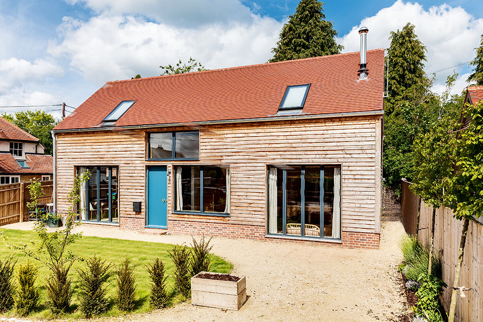 timber clad self build with clay tile roof