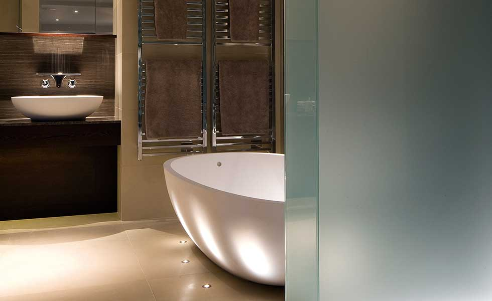 bathroom with egg bath and glass screen plus ambient lighting