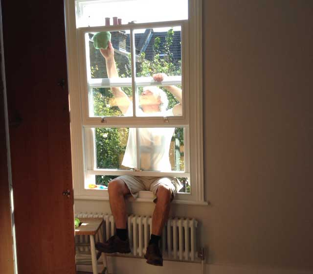 jo dyson's dad cleaning a sash window
