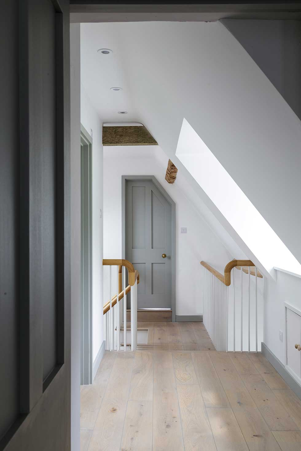 renovated listed cottage grey corridor