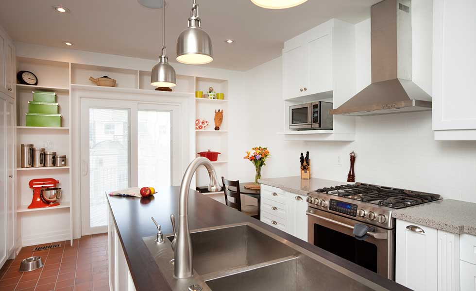 contemporary white kitchen with stainless steel and pendant lights