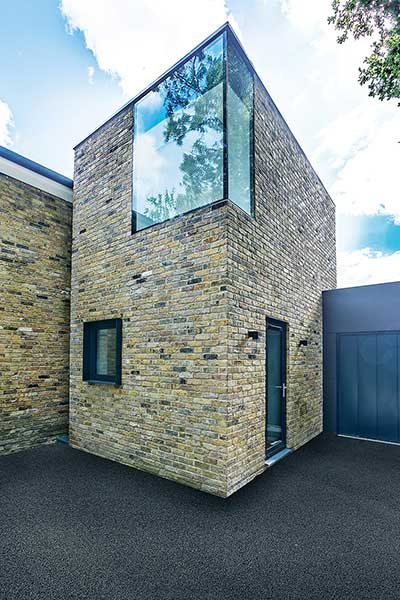 tower extension with glazed corner on modern home