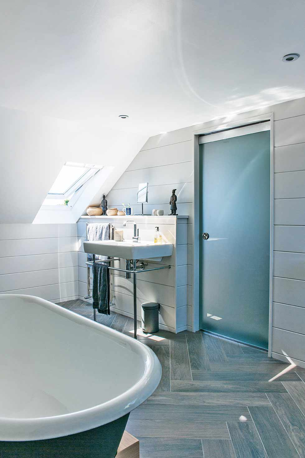 Loft style self build grey bathroom