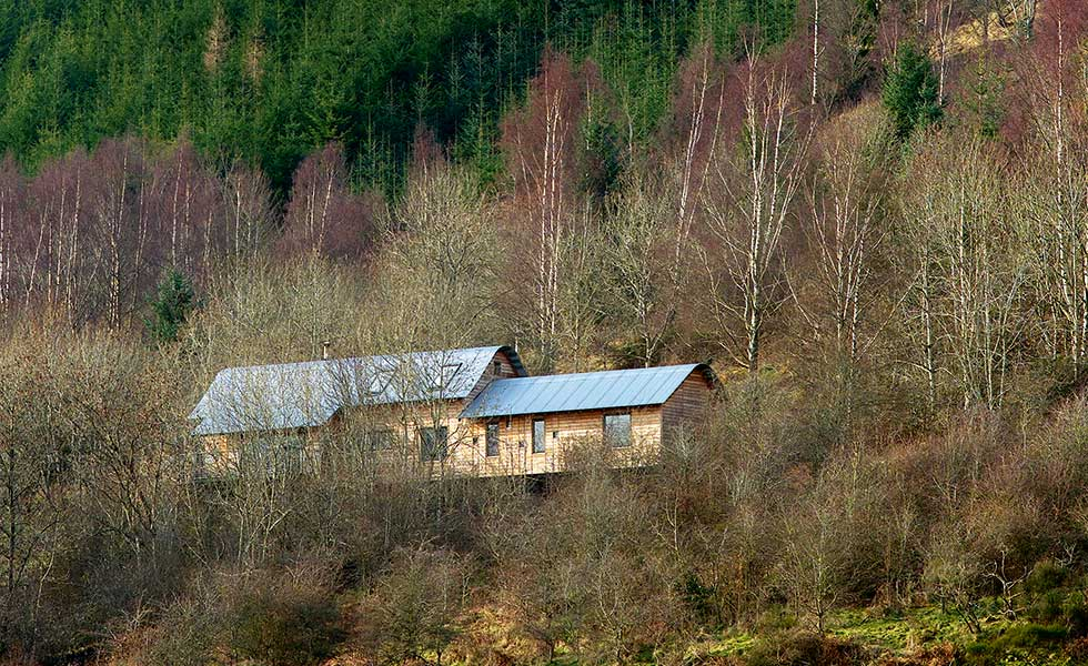 highland wood clad house on a sloping plot