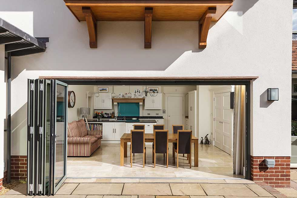 arts & crafts style self build house folding doors