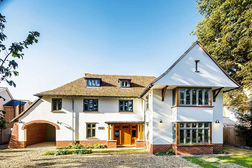 arts & crafts style self build house white front exterior