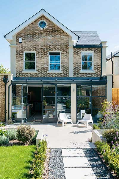 Loft-style self build rear exterior garden