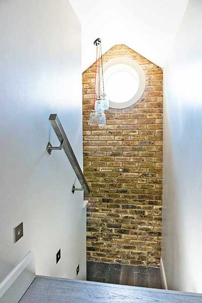 Loft style self build brick wall stairs window