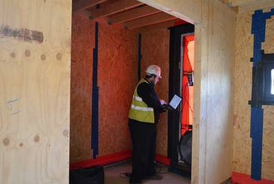 airtightness testing a passivhaus by Potton