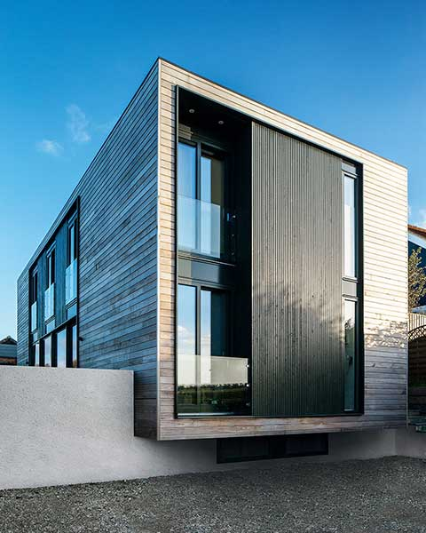 contemporary SIPS self build exterior larch cladding side