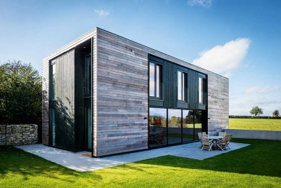 contemporary SIPS self build exterior larch cladding side glazing