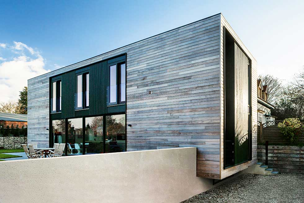 contemporary SIPS self build exterior larch cladding caltilever