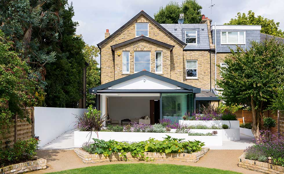 garden view of an extended and remodelled semi detached home