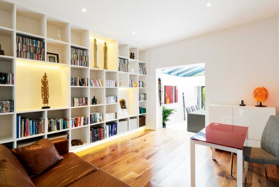 remodelled semi-detached home with living area of fitted bookshelves