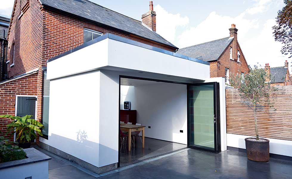 single-storey rendered extension with bi-folds