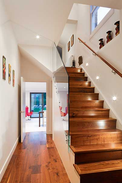 staircase and dark wood flooring in Edwardian extension