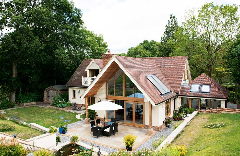 traditional style self build home exterior and garden