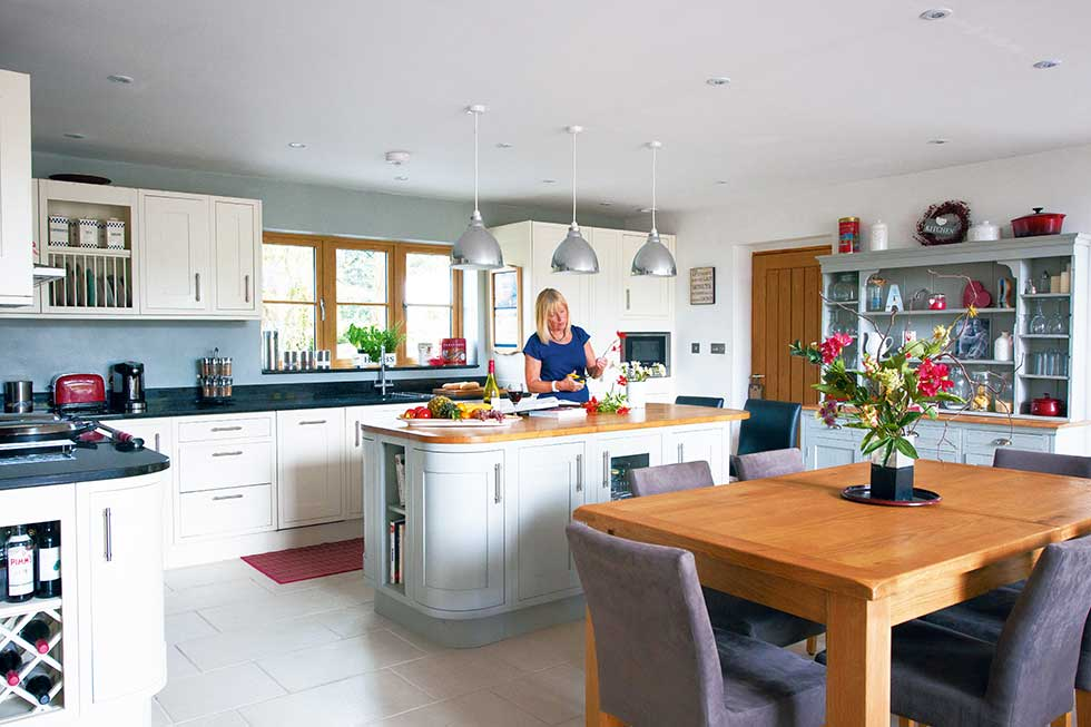 traditional style self build home kitchen diner with homeowner