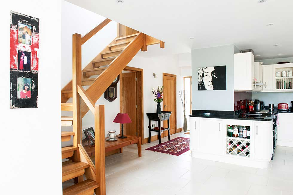 traditional style self build home open wood staircase