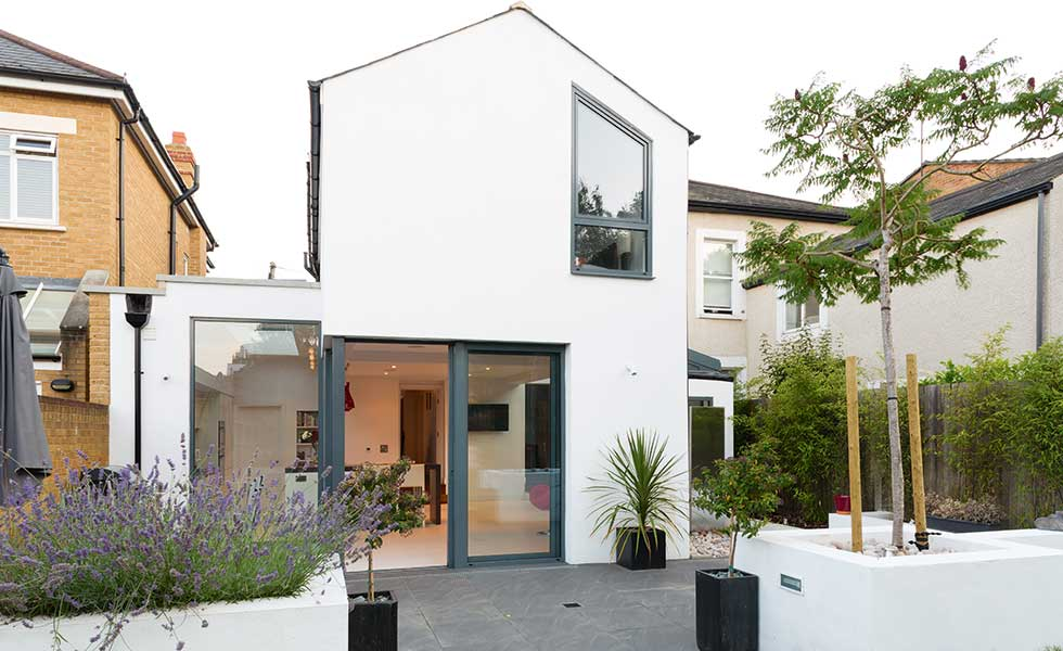 white rendered contemporary extension to Edwardian semi-detached home