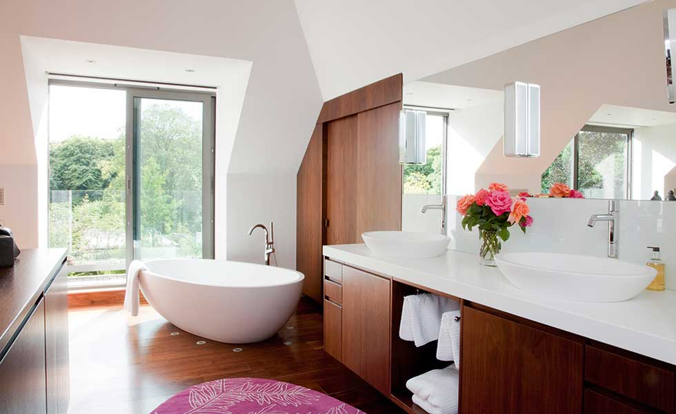 Bathroom in loft with storage space under roof slope