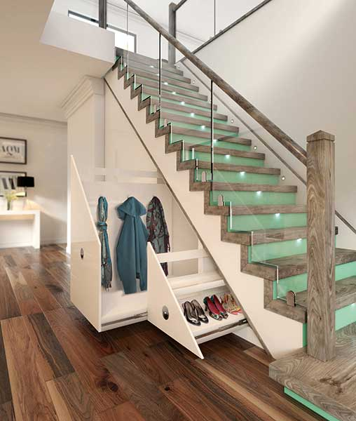 Glass staircase with raw wood newel posts and under stairs drawers