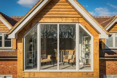 grey timber frame windows exterior of timber clad house