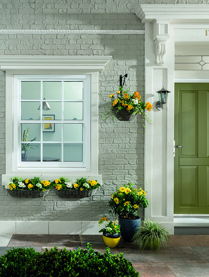 period style sash windows in traditional home exterior