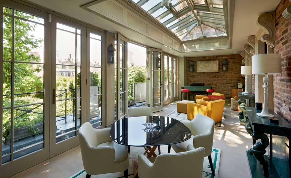 an orangery is a great way to bring the outside in during the summer, while ensuring the space is still practical in the winter months