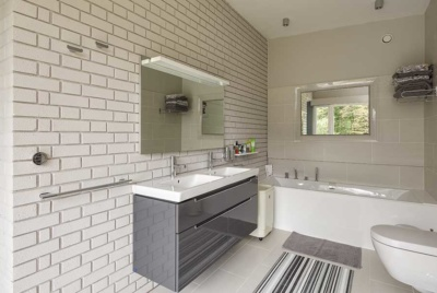 contemporary-bathroom-with-exposed-brick-wall