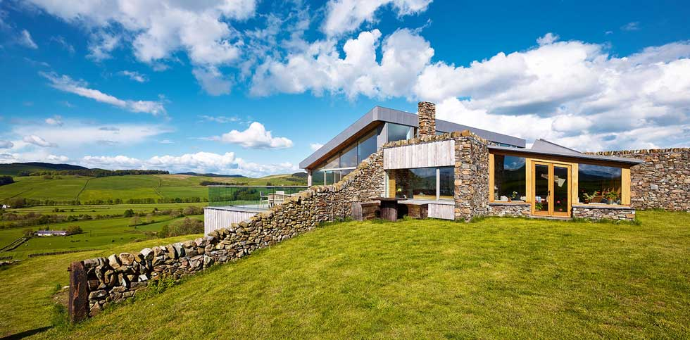 sustainable farmhouse built from stone and timber cladding