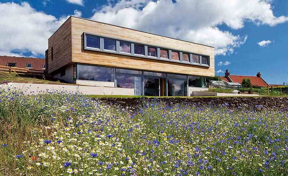 Passivhaus with timber clad upper storey on a sloping site