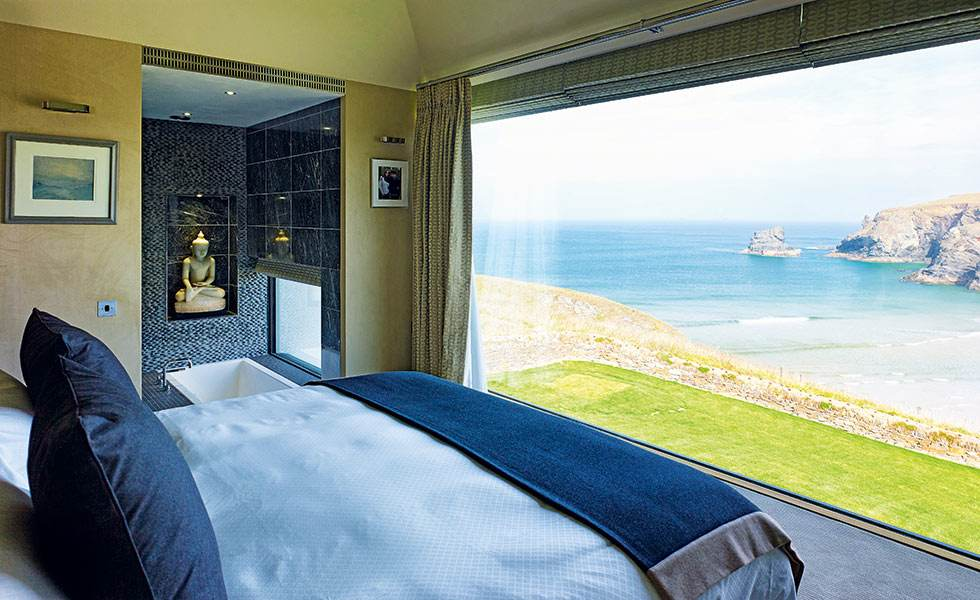 en suite bedroom with large window and sea view