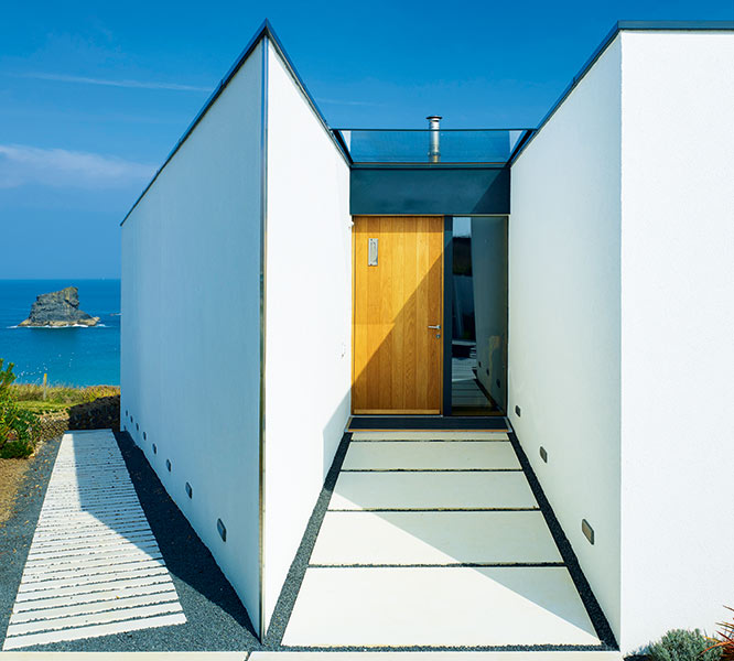 white rendered entrance of cliff top self build