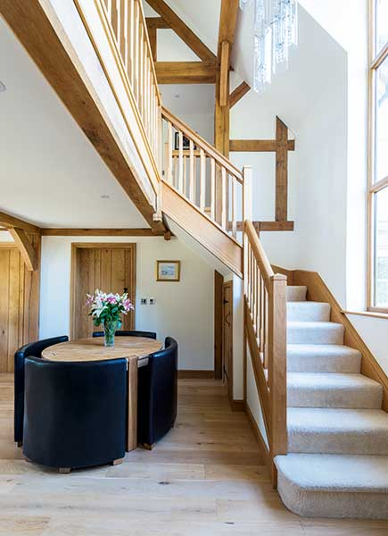 exposed oak frame in hallway and staircase