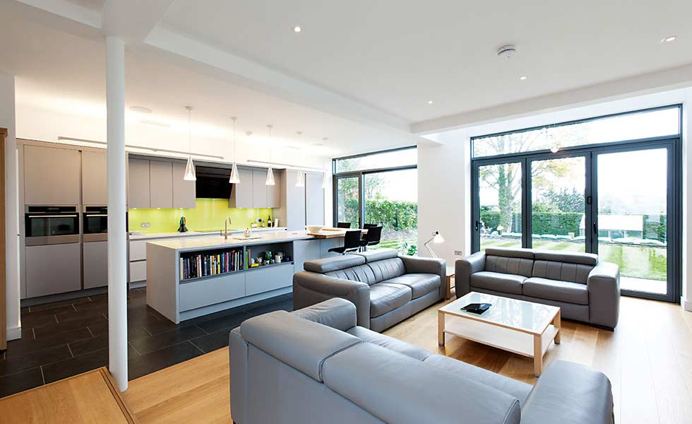 open plan kitchen with large glazed areas and grey units