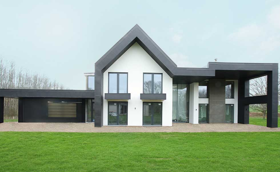 a solar powered house in kent with black metal structural features