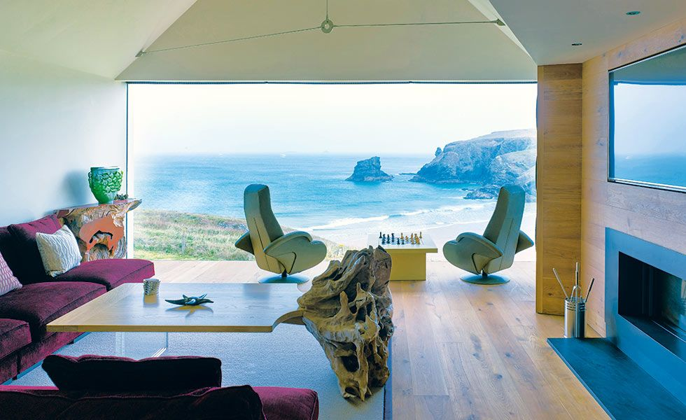 living room with sea views glazing in cliff top self build